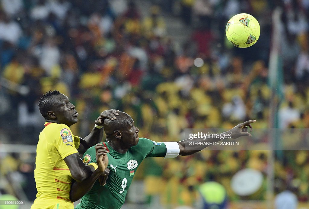 Togo's defender Vincent Bossou (L) vies with Burkina Faso's forward Moumouni Dagano during the African Cup of Nation 2013 quarter final football match Burkina Faso vsTogo, on February 3, 2013 in Nelspruit.