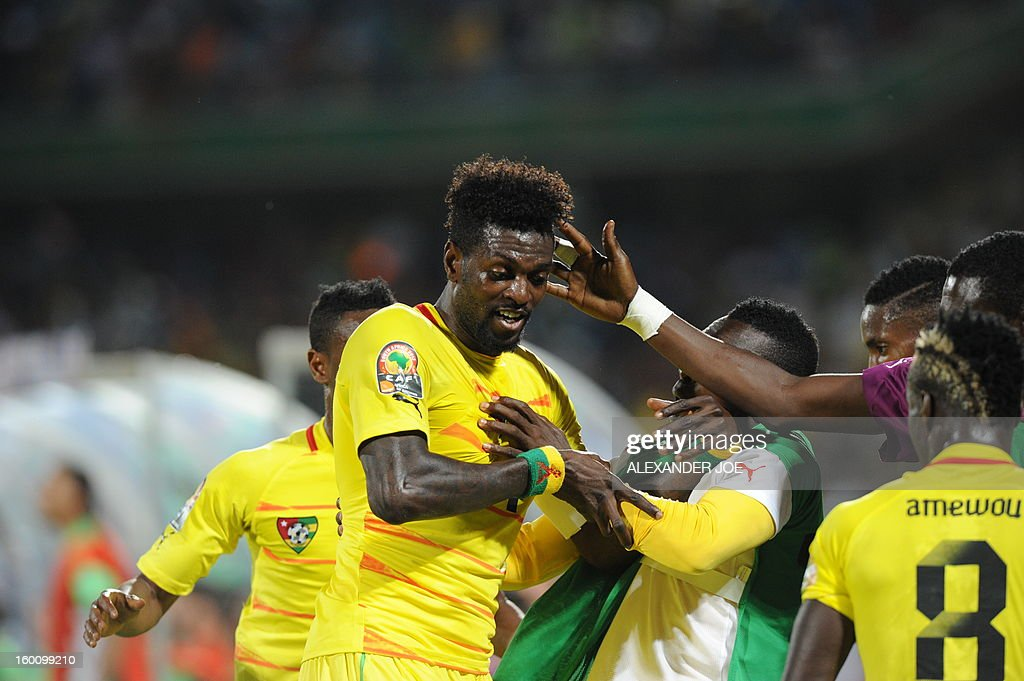 Togo's forward Emmanuel Adebayor (L) celebrates with teammates after scoring during the 2013 African Cup of Nations football match Algeria vs Togo at Royal Bafokeng stadium in Rustenburg on January 26, 2013.