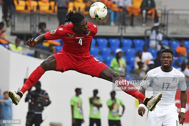 Togo's forward Emmanuel Adebayor heads the ball next to Ivory Coast's defender Serge Aurier during the 2017 Africa Cup of Nations group C football...