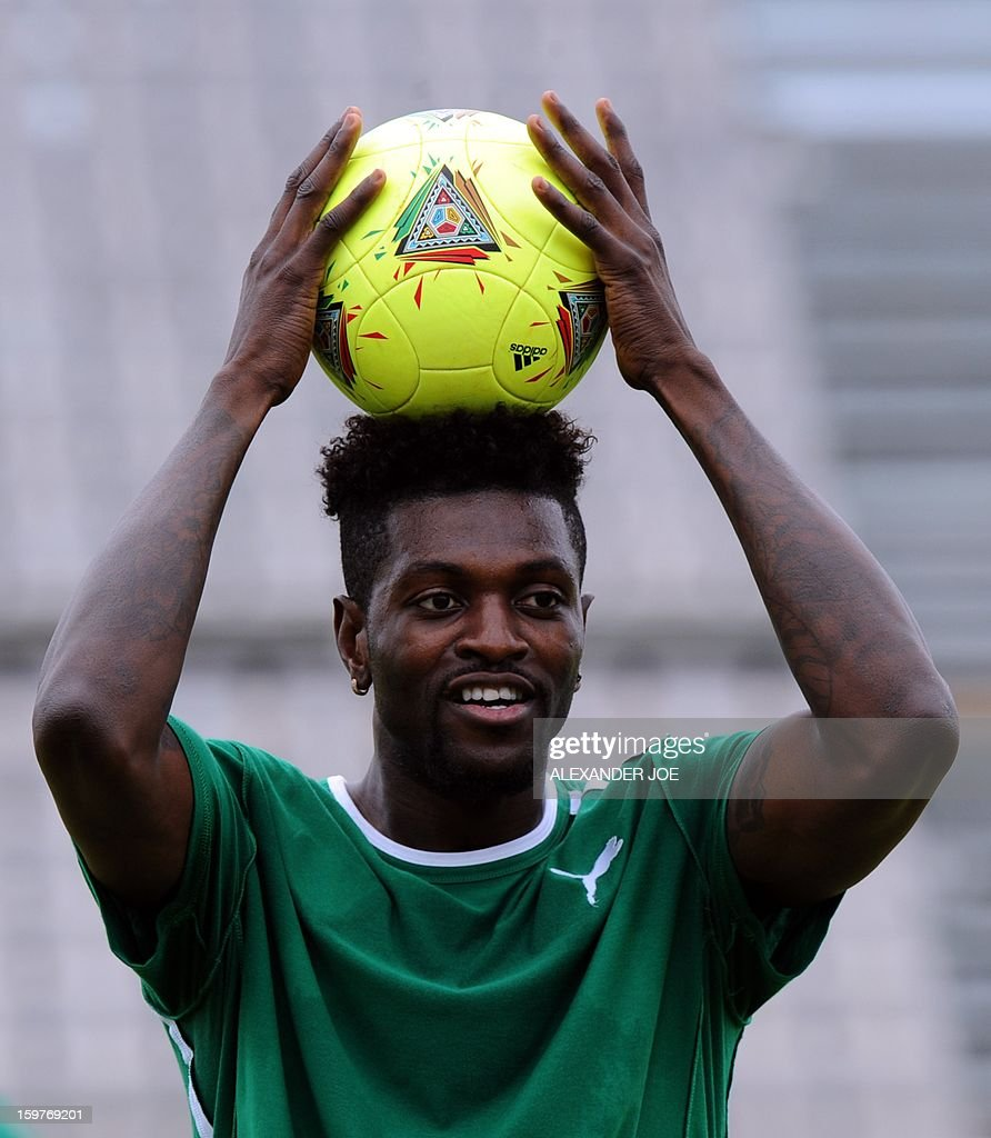 Togo's Forward Emmanuel Adebayor plays with a ball during training in Moruleng on January 20, 2013 at Moruleng Stadium on the eve of their first Group D 2013 Africa Cup of Nations match against Ivory Coast . AFP PHOTO / ALEXANDER JOE