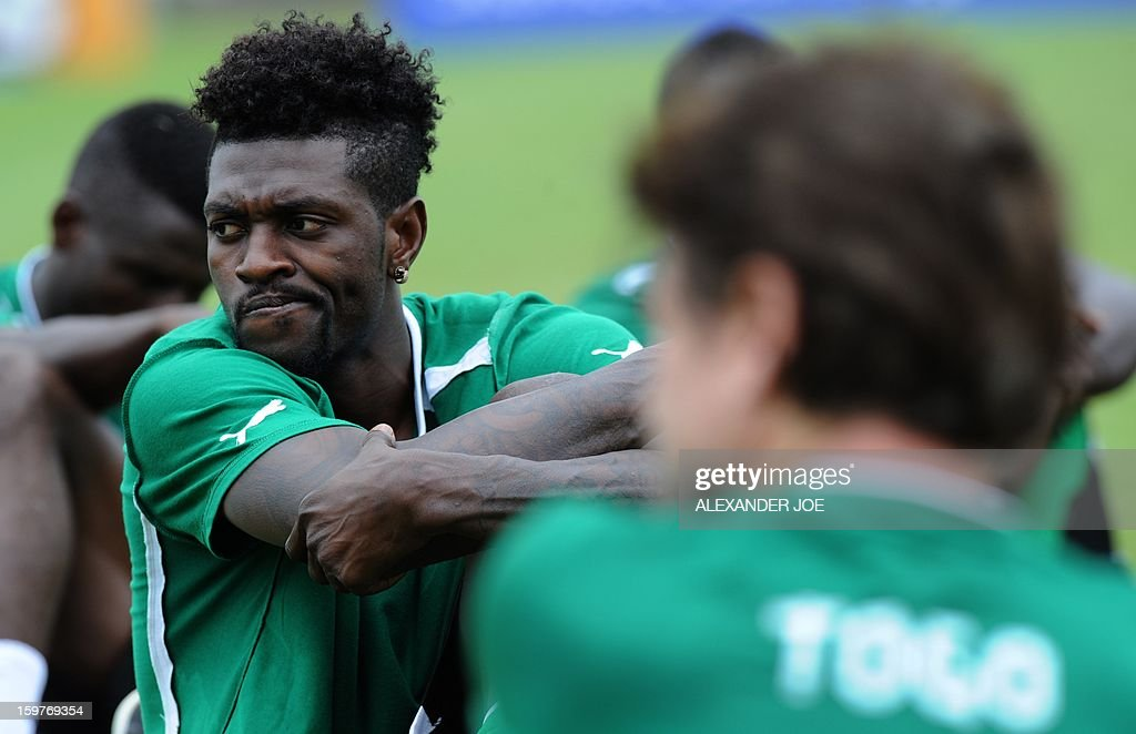 Togo's Forward Emmanuel Adebayor stretches during training in Moruleng on January 20, 2013 at Moruleng Stadium on the eve of their first Group D 2013 Africa Cup of Nations match against Ivory Coast .