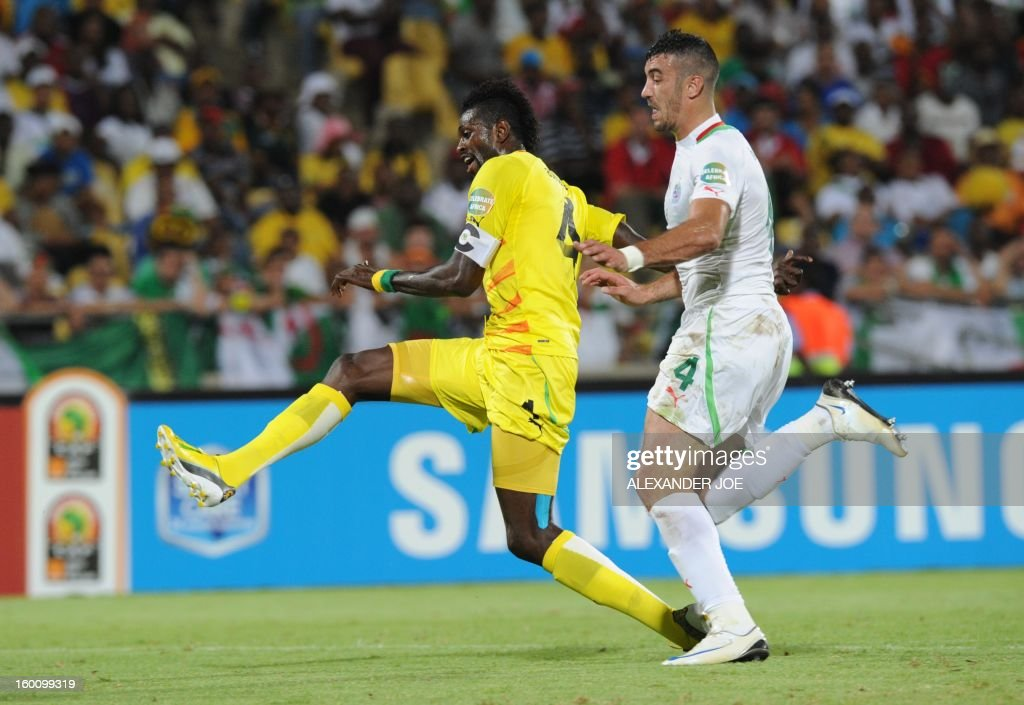 Togo's forward Emmanuel Adebayor vies with an opponent during the 2013 African Cup of Nations football match Algeria vs Togo at Royal Bafokeng stadium in Rustenburg on January 26, 2013.