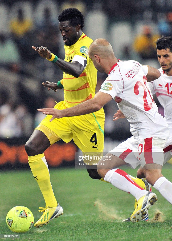 Togo's forward Emmanuel Adebayor (L) vies with Tunisia's defender Aymen Abdennour (R) during the Africa Cup of Nations 2013 group D football match Togo vs Tunisia on January 30, 2013 at the Mbombela stadium in Nelspruit. Togo drew 1-1 with Tunisia today to complete the Africa Cup of Nations quarter-final cast list and send the Carthage Eagles heading back to Tunis. AFP PHOTO / ISSOUF SANOGO