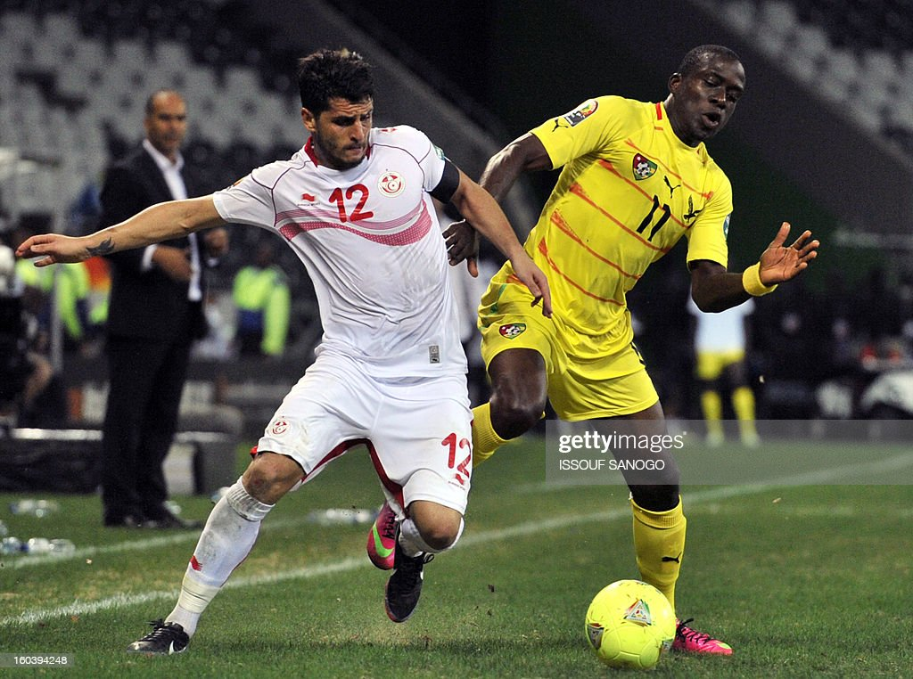 Togo's forward Jonathan Ayite (R) vies with Tunisia's defender Khalil Chemmam (L) during the Africa Cup of Nations 2013 group D football match Togo vs Tunisia on January 30, 2013 at the Mbombela stadium in Nelspruit. Togo drew 1-1 with Tunisia today to complete the Africa Cup of Nations quarter-final cast list and send the Carthage Eagles heading back to Tunis.