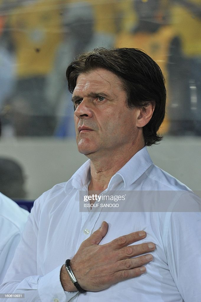Togo's French coach Didier Six listens to the Togolese national anthem prior to the African Cup of Nation 2013 quarter final football match Burkina Faso vsTogo, on February 3, 2013 in Nelspruit.