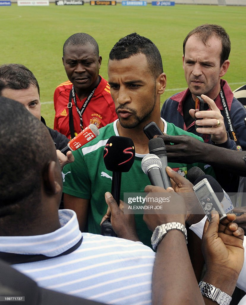 Togo's midfielder Aleixys Romao (C) talks to the media after a training session on January 20, 2013 at Moruleng Stadium in Moruleng, on the eve of a Group D 2013 Africa Cup of Nations match against Ivory Coast.