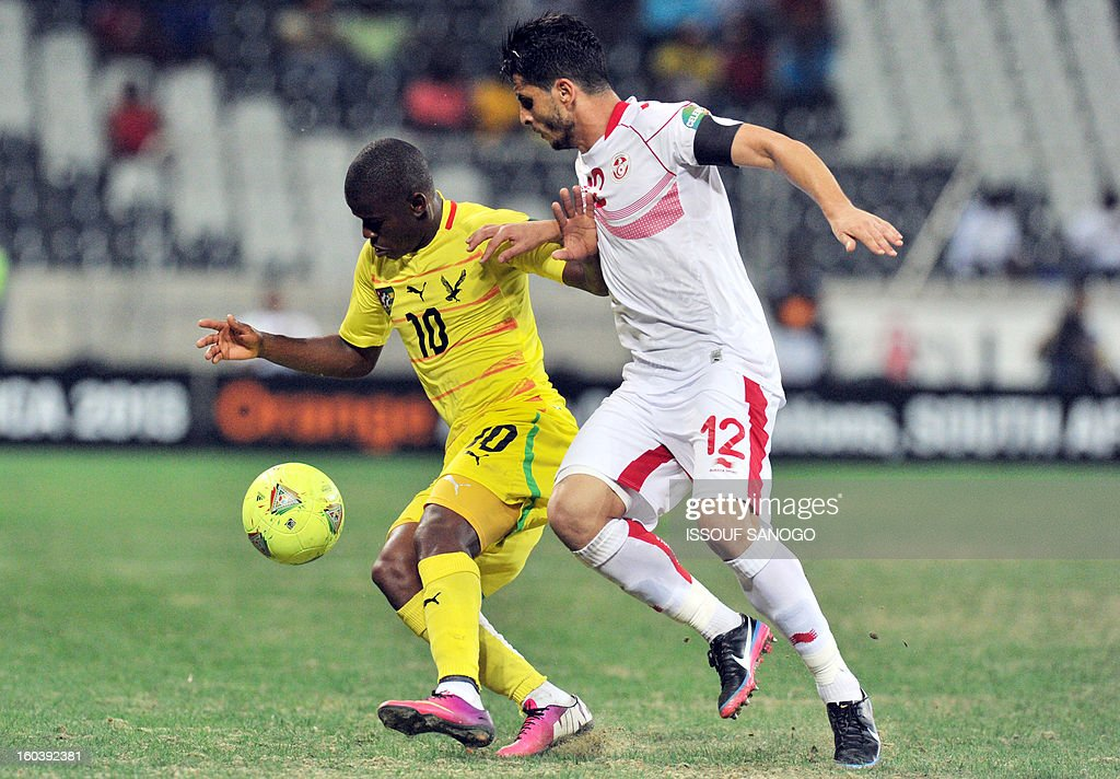 Togo's midfielder Floyd Ayite (L) vies with Tunisia's defender Khalil Chemmam (R) during the Africa Cup of Nations 2013 group D football match Togo vs Tunisia on January 30, 2013 at the Mbombela stadium in Nelspruit. Togo drew 1-1 with Tunisia today to complete the Africa Cup of Nations quarter-final cast list and send the Carthage Eagles heading back to Tunis.