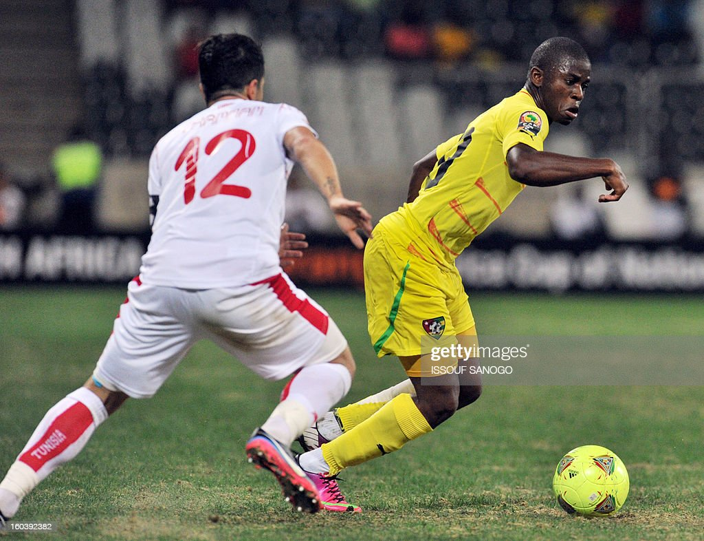 Togo's midfielder Floyd Ayite (R) vies with Tunisia's defender Khalil Chemmam (L) during the Africa Cup of Nations 2013 group D football match Togo vs Tunisia on January 30, 2013 at the Mbombela stadium in Nelspruit. Togo drew 1-1 with Tunisia today to complete the Africa Cup of Nations quarter-final cast list and send the Carthage Eagles heading back to Tunis.