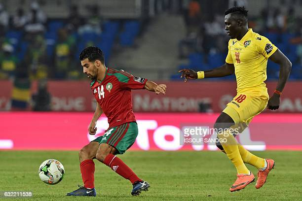 Togo's midfielder Lalawele Atakora challenges Morocco's midfielder Mbarek Boussoufa during the 2017 Africa Cup of Nations group C football match...