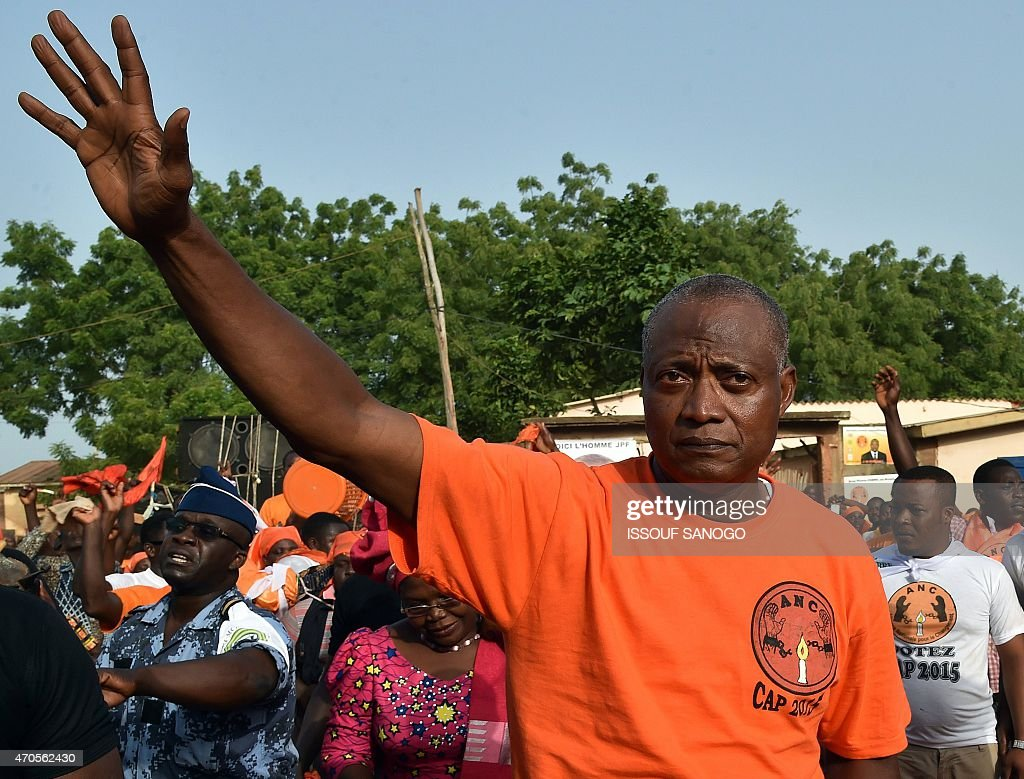 Togo's opposition leader and Alliance for National change candidate for Togo's presidential election, <a gi-track='captionPersonalityLinkClicked' href=/galleries/search?phrase=Jean-Pierre+Fabre&family=editorial&specificpeople=2329955 ng-click='$event.stopPropagation()'>Jean-Pierre Fabre</a>, waves to supporters during a presidential campaign meeting on April 21, 2015 in village of Anfoin, some 55 km east from Lome. Togo votes for a new president on April 25, with main opposition leader <a gi-track='captionPersonalityLinkClicked' href=/galleries/search?phrase=Jean-Pierre+Fabre&family=editorial&specificpeople=2329955 ng-click='$event.stopPropagation()'>Jean-Pierre Fabre</a> seeking to end nearly 50 years of rule by the Gnassingbe family.