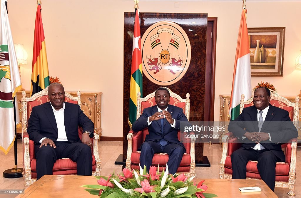 Togo's President Faure Gnassingbe attends a meeting with Ghanian President and ECOWAS chairmen John Dramani Mahama and Ivory Coast President Alassane...