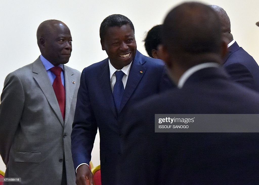 Togo's President Faure Gnassingbe (C) leaves the conference room after a meeting with Ghanian President and ECOWAS chairmen <a gi-track='captionPersonalityLinkClicked' href=/galleries/search?phrase=John+Dramani+Mahama&family=editorial&specificpeople=6829053 ng-click='$event.stopPropagation()'>John Dramani Mahama</a> and Ivory Coast president <a gi-track='captionPersonalityLinkClicked' href=/galleries/search?phrase=Alassane+Ouattara&family=editorial&specificpeople=697562 ng-click='$event.stopPropagation()'>Alassane Ouattara</a> at the presidential palace in Lome on April 28, 2015. AFP PHOTO / ISSOUF SANOGO