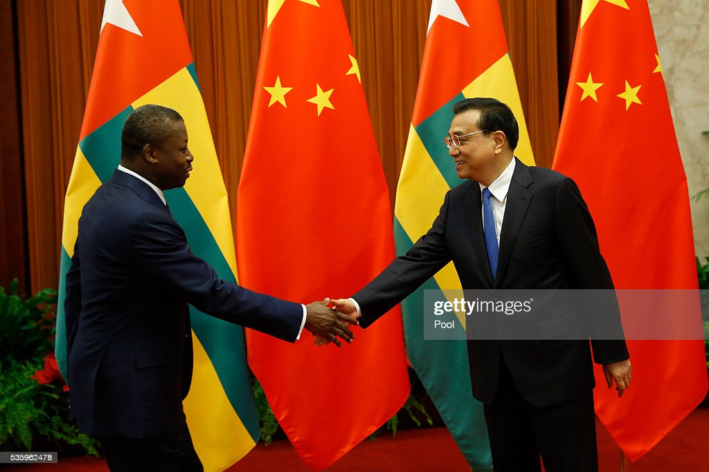 Togo's President Faure Gnassingbe (L) meets with Chinese Premier <a gi-track='captionPersonalityLinkClicked' href=/galleries/search?phrase=Li+Keqiang&family=editorial&specificpeople=2481781 ng-click='$event.stopPropagation()'>Li Keqiang</a> (R) at the Great Hall of the People on May 31, 2016 in Beijing, China.