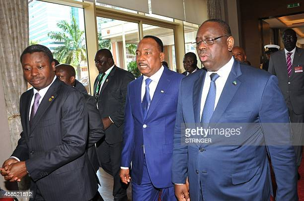 Togo's president Faure Gnassingbe Niger's president Mahamadou Issoufou and Senegal's president Macky Sall speak as they arrive arrive at the...