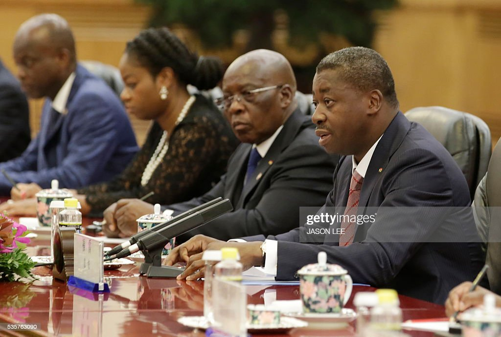 Togo's President Faure Gnassingbe (R) talks with China's President Xi Jinping (not in picture) during a meeting at the Great Hall of the People in Beijing on May 30, 2016. / AFP / POOL / JASON LEE