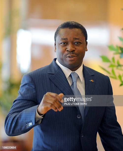 Togo's President Faure Gnassingbe waves as he arrives for an ECOWAS Summit gathering west African leaders to plot a military strategy to wrest...