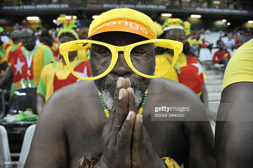 A Togo's supporter poses prior to the African Cup of Nation 2013 quarter final football match Burkina Faso vsTogo, on February 3, 2013 in Nelspruit. AFP PHOTO / ISSOUF SANOGO