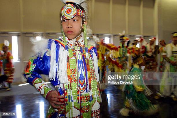 Tohee Funmaker a HoChunk Indian from Reedburg Wisconsin waits his turn to enter the dance arena at the 20th annual Gathering Of Nations PowWow April...