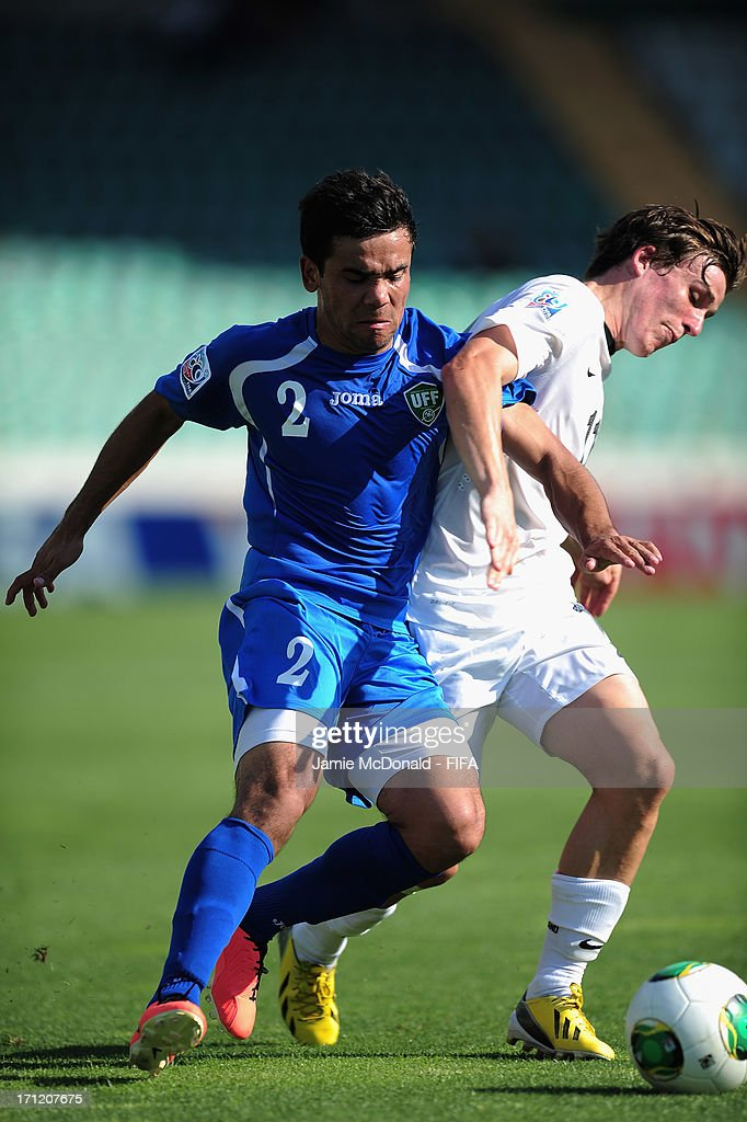 Tohirjon Shamshitdinov of Uzbekistan battles with Louis Fenton of New Zealand during the FIFA U-20 World Cup Group F match between New Zealand and Uzbekistan at the Ataturk Stadium on June 23, 2013 in Bursa, Turkey.