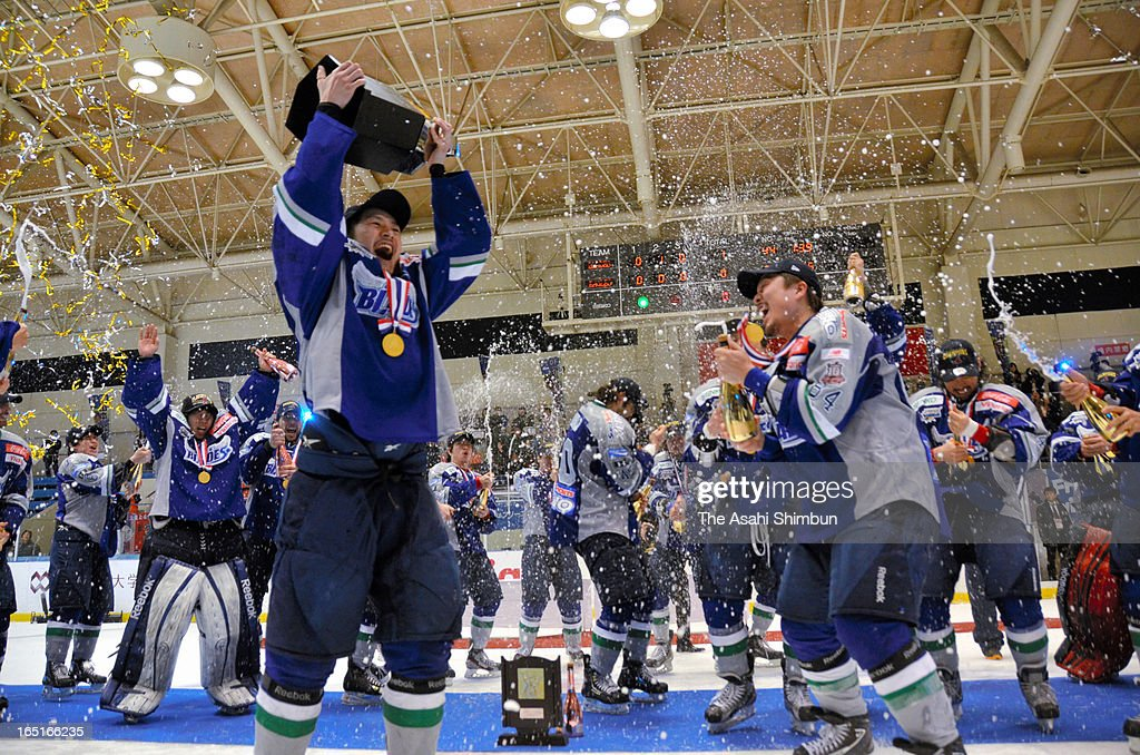 Tohoku Free Blades players celebrate winning the Asia League Ice Hockey Play-Off Final match between Tohoku Free Blades and Oji Eagles at Niida Indoor Rink on March 30, 2013 in Hachinohe, Aomori, Japan.