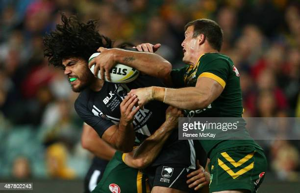 Tohu Harris of New Zealand is tackled by Josh Morris during the ANZAC Test match between the Australian Kangaroos and the New Zealand Kiwis at...