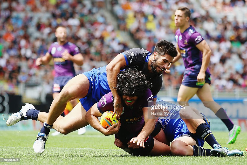 Tohu Harris of the Melbourne Storm is tackled by <a gi-track='captionPersonalityLinkClicked' href=/galleries/search?phrase=James+Tamou&family=editorial&specificpeople=5563889 ng-click='$event.stopPropagation()'>James Tamou</a> of the North Queensland Cowboys during the 2016 Auckland Nines quarter final match between the Melbourne Storm and the North Queensland Cowboys at Eden Park on February 7, 2016 in Auckland, New Zealand.