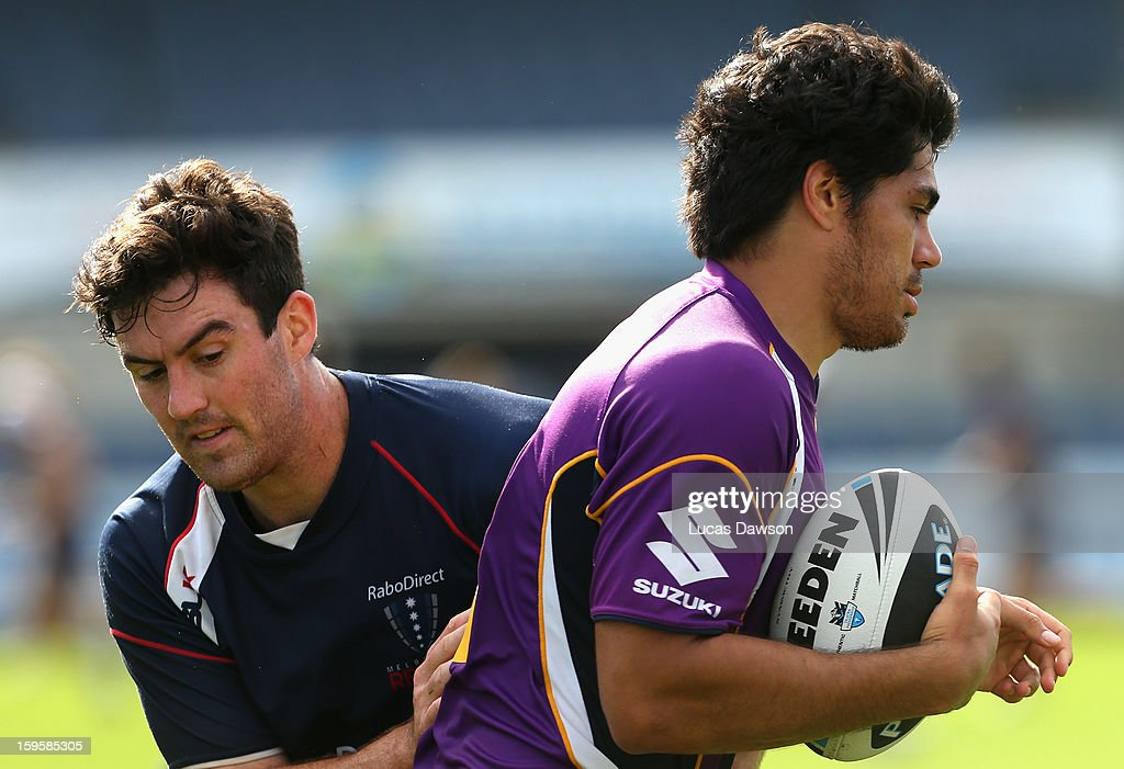 Tohu Harris of the Storm carries the ball during a Melbourne Storm and Melbourne Rebels training session at Visy Park on January 17, 2013 in Melbourne, Australia.