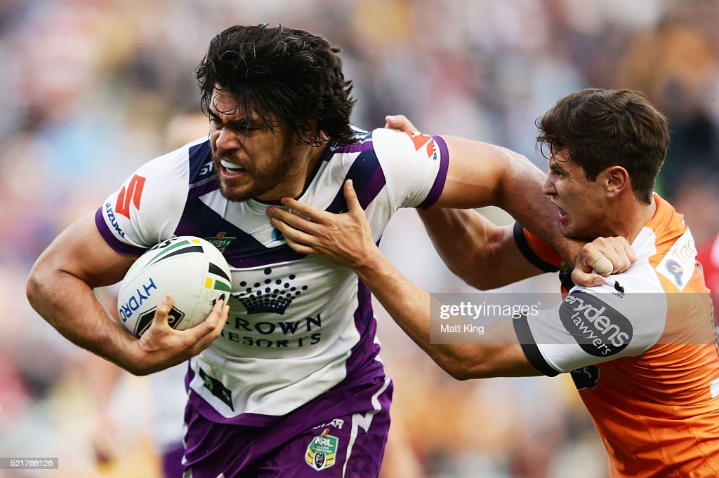 Tohu Harris of the Storm is tackled by Mitchell Moses of the Tigers during the round seven NRL match between the Wests Tigers and the Melbourne Storm at Leichhardt Oval on April 17, 2016 in Sydney, Australia.