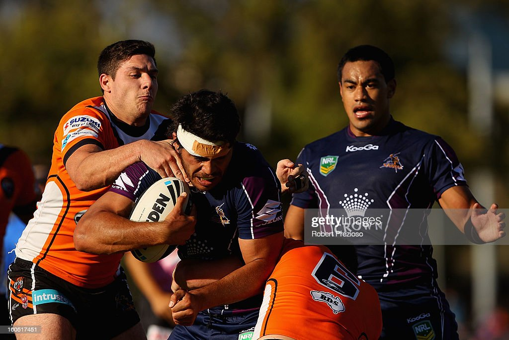 Tohu Harris of the Storm is tackled during the NRL trial match between the Melbourne Storm and Brisbane Easts at Gosch's Paddock on February 2, 2013 in Melbourne, Australia.