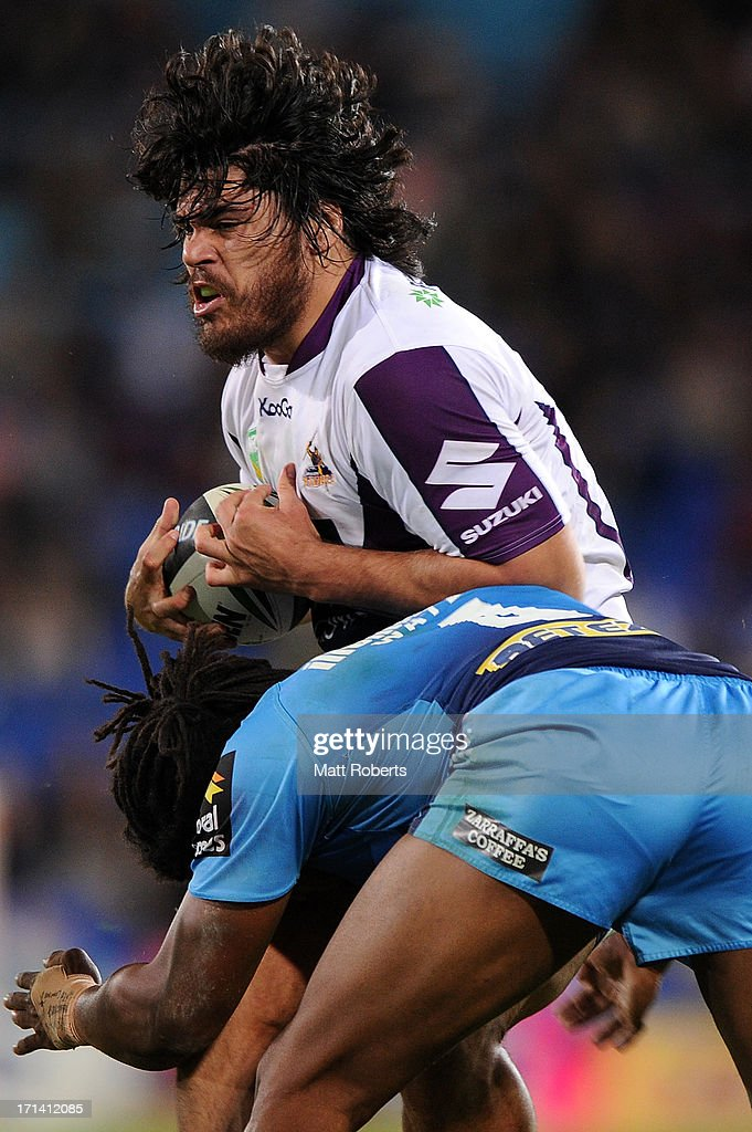 Tohu Harris of the Storm is tackled during the round 15 NRL match between the Gold Coast Titans and the Melbourne Storm at Skilled Park on June 24, 2013 on the Gold Coast, Australia.