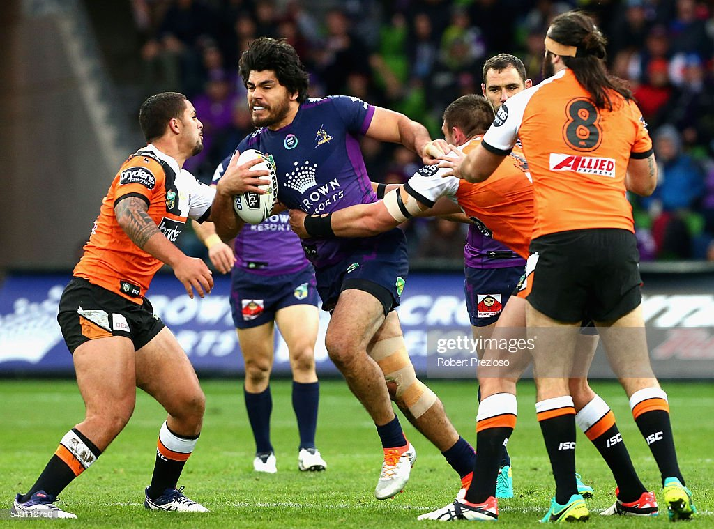 Tohu Harris of the Storm is tackled during the round 16 NRL match between the Melbourne Storm and Wests Tigers at AAMI Park on June 26, 2016 in Melbourne, Australia.