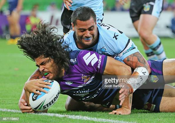 Tohu Harris of the Storm scores a try during the round three NRL match between the Melbourne Storm and the Cronulla Sharks at AAMI Park on March 21...
