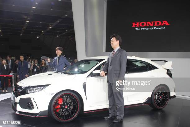 Toichi Ishiyama managing director of Honda Malaysia Sdn Bhd unveils the allnew Civic Type R dubbed 'the world's fastest frontwheeldrive car' at the...