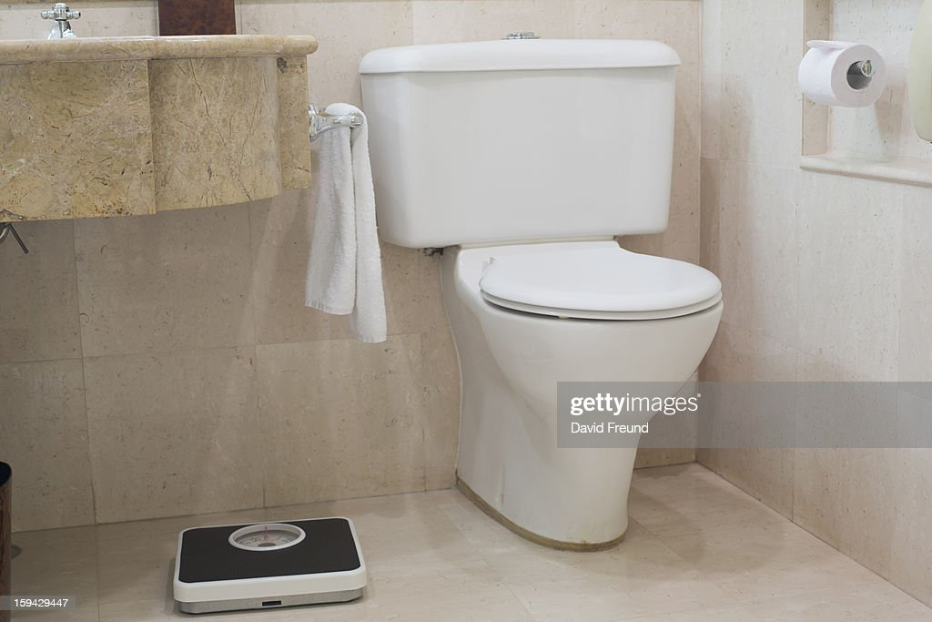 Toilet and Scales : Stock Photo