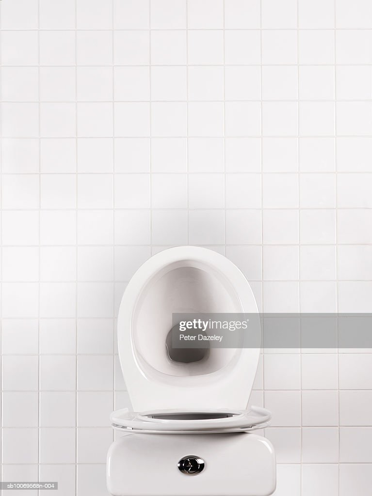 Toilet bowl in bathroom, directly above