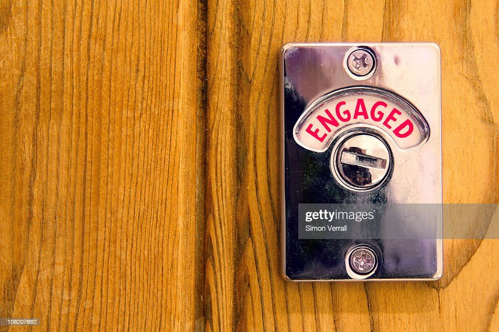 Toilet engaged door sign