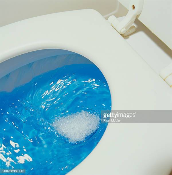 Toilet flushing, close-up of water in toilet