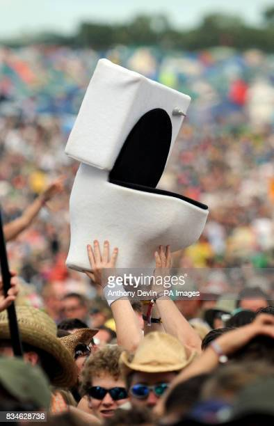 A toilet is passed through the crowd as James Blunt performs on the Pyramid stage during day two of the Glastonbury Festival Somerset