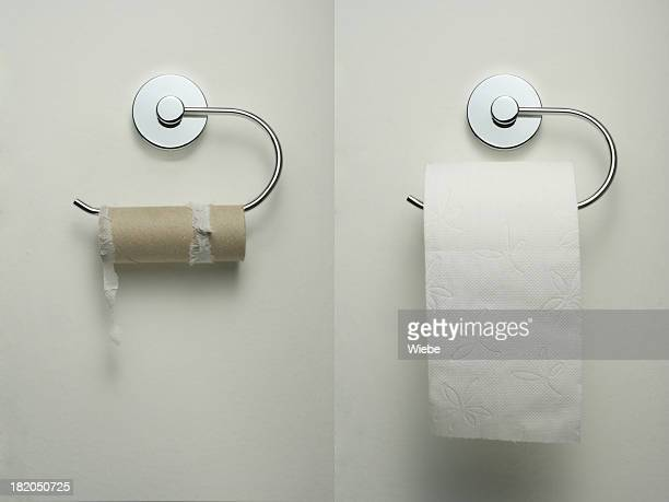 Toilet paper holder with empty and new roll hanging up