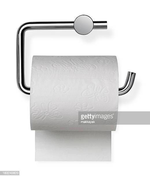 Toilet paper sitting on its holder
