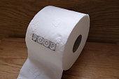 toilet paper with the poop inscription