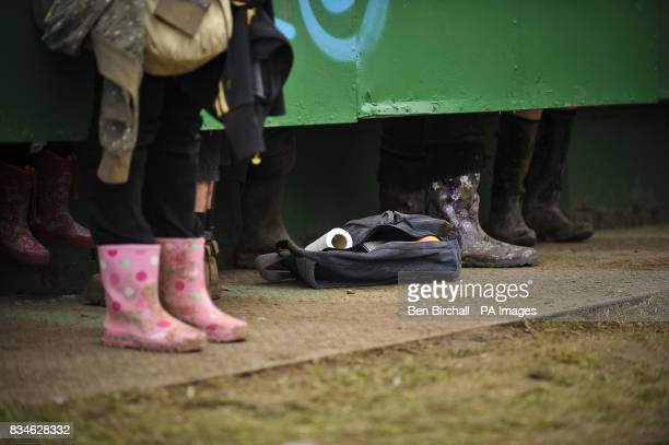 A toilet roll lays on a bag in the toilets during day two of the Glastonbury Festival Somerset