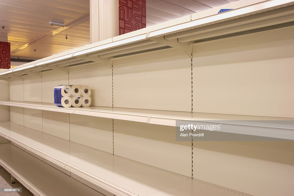 Toilet rolls on empty shop shelf : Stock Photo