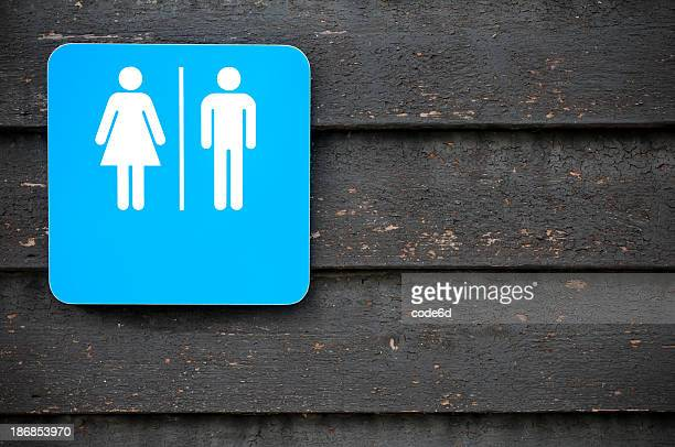 Toilet sign, modern look on old wooden background, copy space