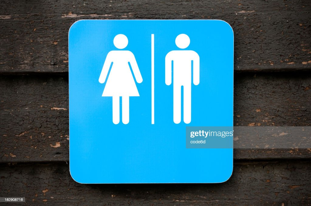 'Toilet sign, modern look on old wooden background'