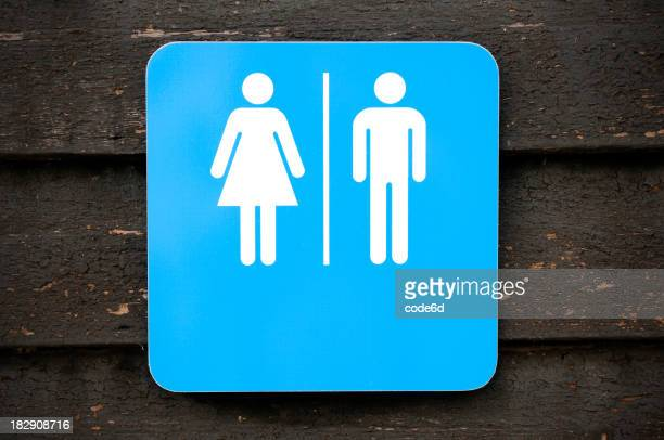 Toilet sign, modern look on old wooden background