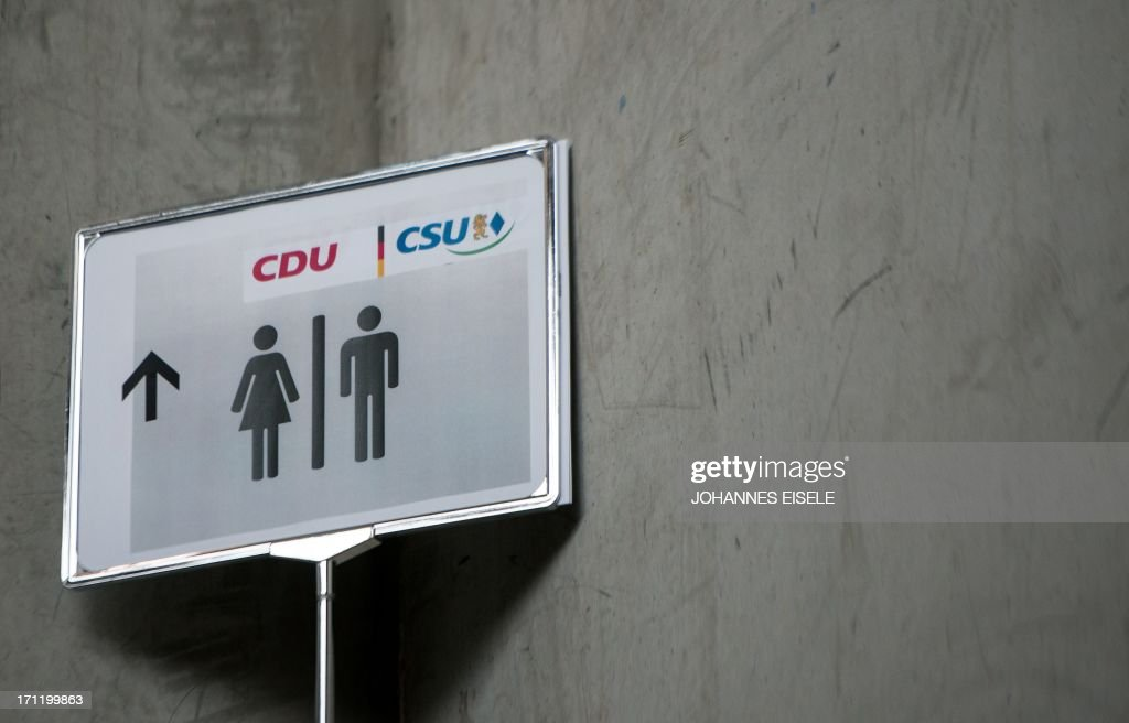 A toilet sign with the logo of the Christian Democratic Union and the Christian Social Union (CDU-CSU) is pictured at a party meeting on June 23, 2013 in Berlin, with120 top delegates to sign off the programme for the upcoming September 22 legislative elections.Three months before Germany goes to the polls, Angela Merkel's conservatives were set to present billions of euros worth of election pledges Sunday, June 23, 2013, sparking criticism that the European austerity champion is showering voters with costly campaign gifts.