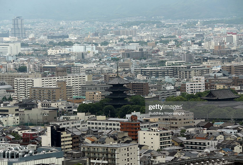 A Toji temple pagoda (C) and commercial buildings are seen on July 5, 2014 in Kyoto, Japan. Kyoto has been named the world's best city in the U.S. magazine Travel + Leisure for 2014, according to its website. The former capital of Japan is known for old temples and shrines.