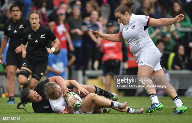 Toka Natua of New Zealand and Deven Owsiany of USA during the Womens Rugby World Cup semifinal between New Zealand and USA at the Kingspan Stadium on...
