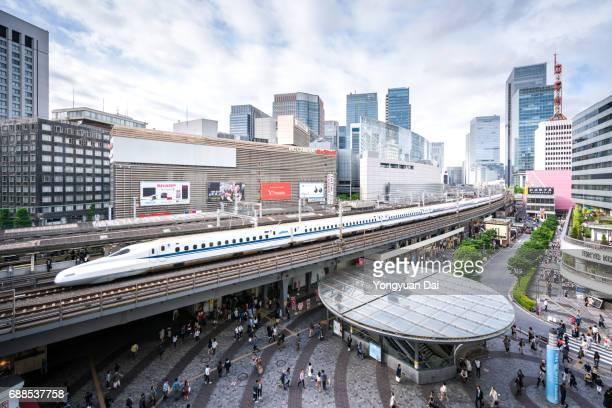 Tokaido Shinkansen Bullet Train Riding Through Downtown Tokyo